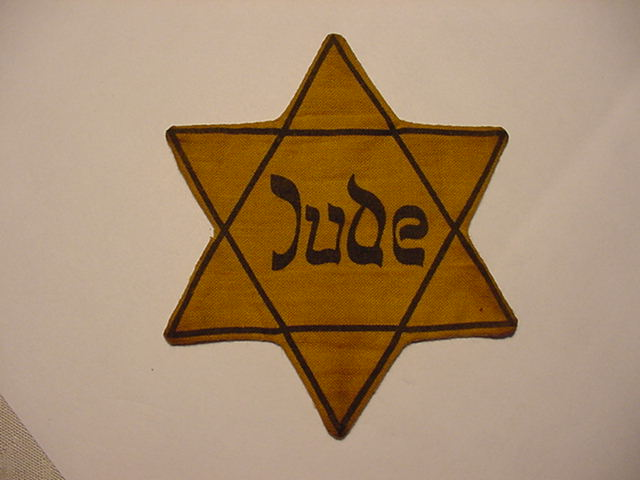 JEWISH STAR OF DAVID AS WORN IN THE GHETTO AND CONCENTRATION CAMPS HOLOCAUST